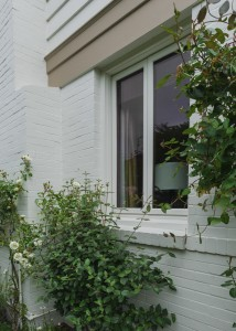 Notice the sharp, clean edges between the taupe band and the white brick and siding.